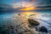 Sunset Over The Mud Flats Of T...