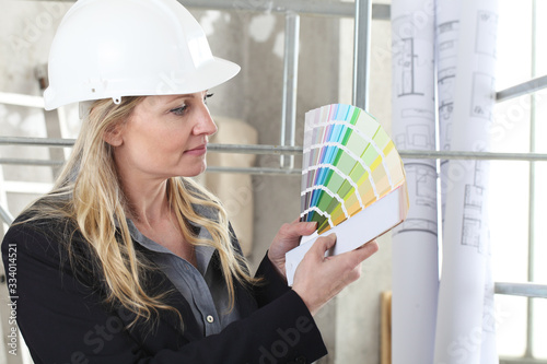 woman architect or construction interior designer with color swatches palette ch Fototapet