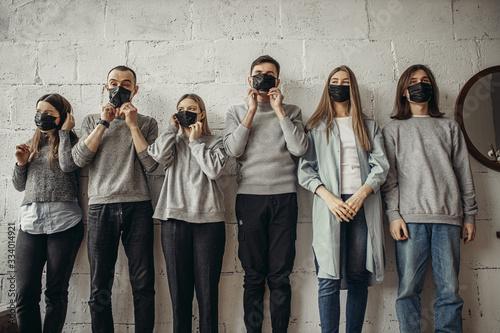 Photo young alarmists wearing protective medical masks, they afraid of coronavirus, COVID-19, flu