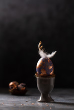 Golden Egg. Easter Gold Egg Wth Feather Above. Easter Egg Decoration With Patina