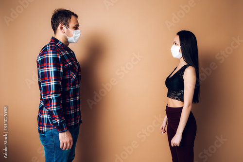 Safe distance between a man and a woman with coronavirus Canvas Print