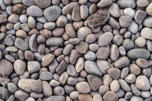Photo Seamless uniform neat clean multicolour gravel cobbled stone texture background