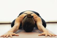 Yogi Woman Practices Child Pos...