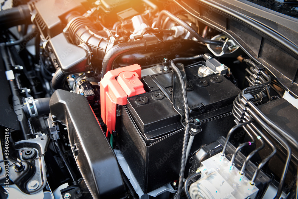 Fototapeta battery car engine detail motor - close up of machine new batteries car engine checking car battery cleaning for deliver customers in the car service