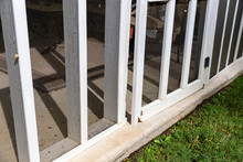 Wooden Screen Door On Back Porch With Rotten Wood
