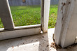 canvas print picture - Close-up of damaged wood on exterior screen door of a porch, in need of repair.
