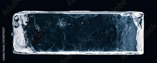 Photo Ice block, on white surface, isolated on black background