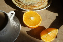 Pancakes And Oranges On The Ta...