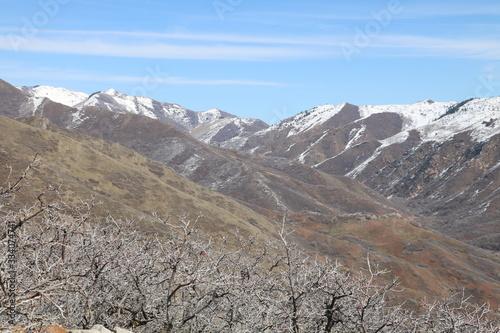 Wasatch Mountain Range in early spring from summit of Mt Van Cott, Salt Lake City, Utah, USA