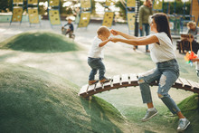 Family In A Park. Mother With Son. People On A Playground.