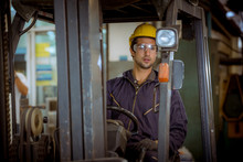 Portrait Worker Industry Factory Wear Safety Uniform Factory Drive A Forklift Car And Open Car Light To Control Production Work In Factory Area For Another Worker.