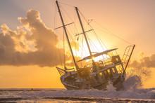 Sailing Boat Wreck At Sunset