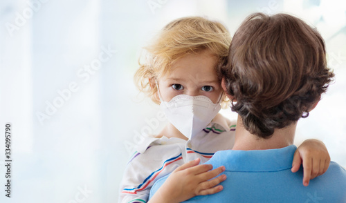 Father and child with face mask and hand sanitizer