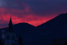 Pink Sunlit Sky Over Church In...
