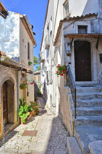A narrow street between the old houses of Castelvetere sul Calore, village in th Canvas Print