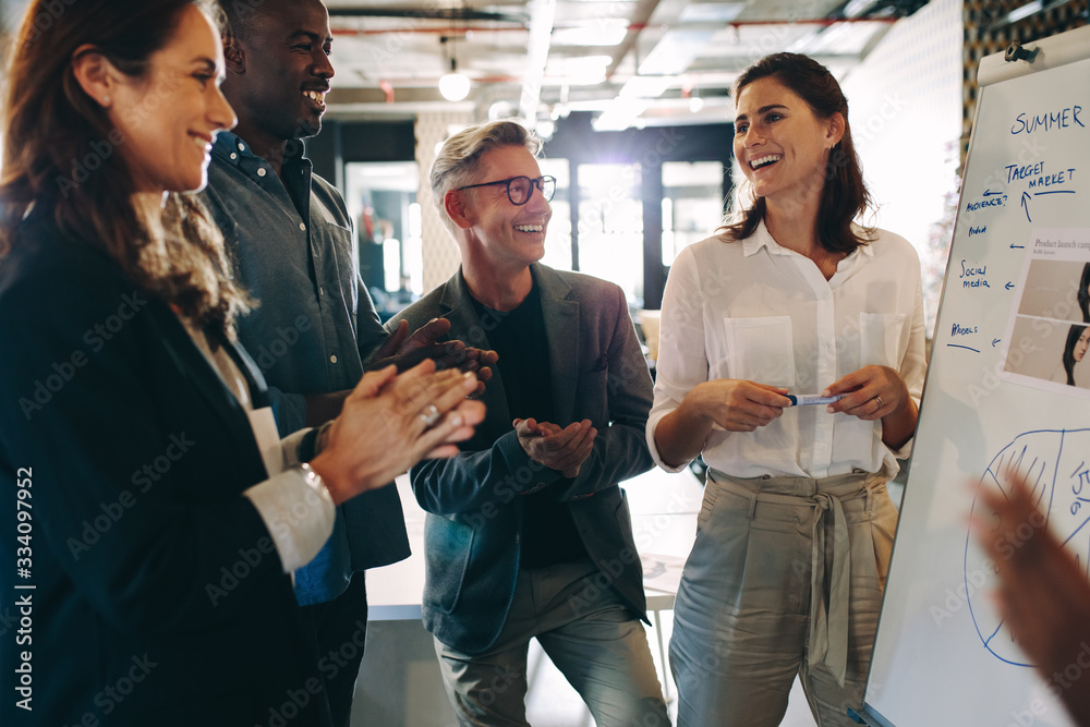 Fototapeta Business team applauding a successful presentation