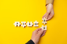 """Hands Of Businessmen Folded The Word """"Plan A B"""" From Puzzles On A Yellow Background. Success Strategy And Alternative Problem Solving."""