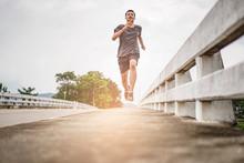 Asian Teenager Running Along T...