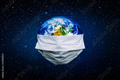 The whole earth is quarantined, the earth is wearing a mask Coronavirus and Air pollution pm2.5 concept. COVID-19 Elements of this image furnished by NASA