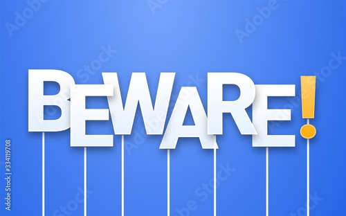 Photo White Beware text on blue background