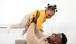 Leinwandbild Motiv family, fatherhood and people concept - happy african american father playing with baby daughter at home