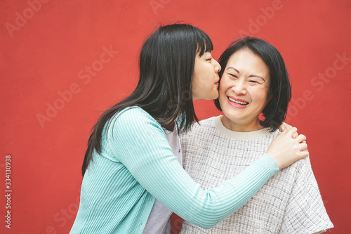 Fotografie, Tablou Happy Asian mother and daughter having fun outdoor - Portrait family people spen