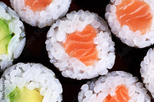 Fototapeta Sushi maki with salmon and avocado. Top view. obraz