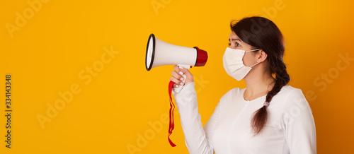 Woman in medical mask with megaphone Wallpaper Mural