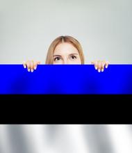 Estonia. Happy Girl Showing Estonian Flag Banner