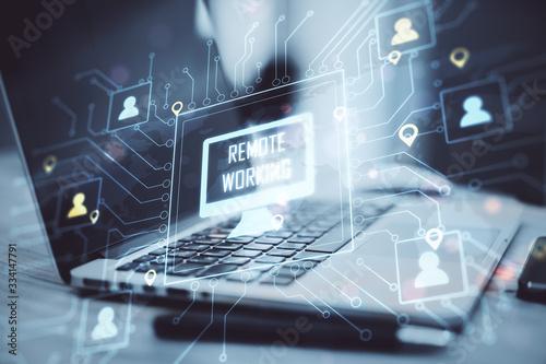 Obraz na plátně Laptop on coworking workplace with remote work interface.