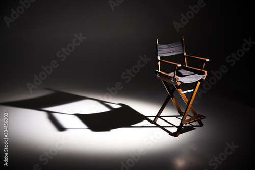 Fotografia Directors chair stands in the beam of light