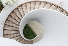 An Empty Outdoor Spiral Staircase With Tile.