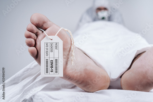 Deceased's data on sign attached to a big toe Canvas Print