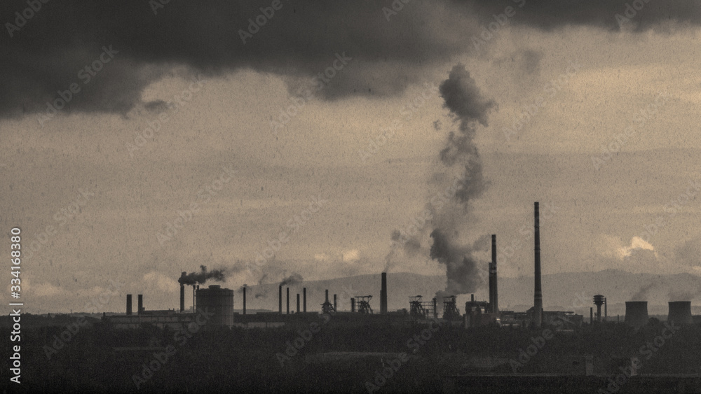 Fototapeta Polluted industrial area. Silhouettes of factories with smoking chimneys. Dark grunge mood