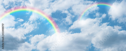 rainbow in blue sky.