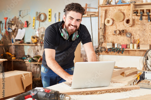 Craftsman as a creative founder with laptop Canvas Print