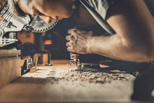 Carpenter Working With Plane O...