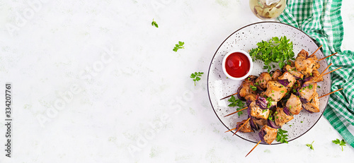 Fotografie, Obraz Grilled chicken kebab with red onions on a light table