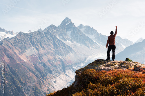 Amazing view on Monte Bianco mountains range with tourist on a foreground. Vallon de Berard Nature Preserve, Chamonix, Graian Alps. Landscape photography