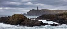 Shot Of Rocky Coast With Tiny ...