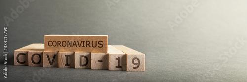 Fotografía Coronavirus COVID-19 inscription on wooden blocks