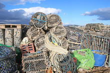 Lobster Pots On The Harbour Wall