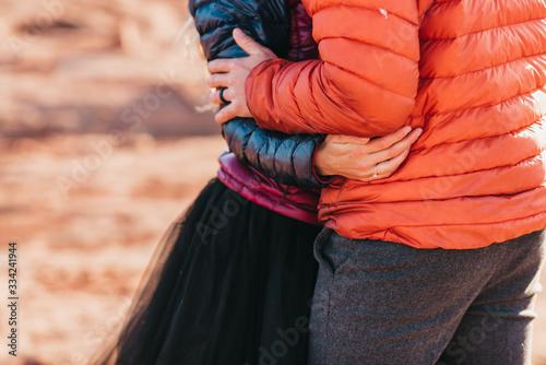 Obraz na plátně husband and wife embracing during adventure elopement