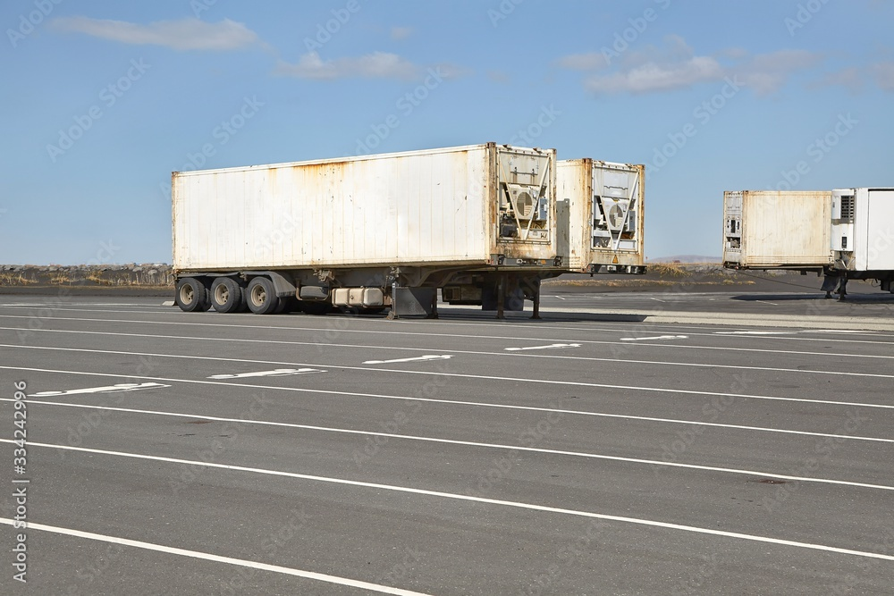 Fototapeta Cargo containers in truck trailers in a parking lot in Iceland