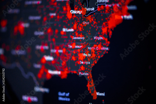Obraz United States, East Coast, New York, . Coronavirus COVID-19 global cases Map. Red Point showing the number of infected. World map on monitor display. - fototapety do salonu