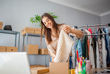 Everyone Do Shopping Online. Woman Packing Item That She Sells Online. Women, Owener Of Small Business Packing Product In Boxes, Preparing It For Delivery.