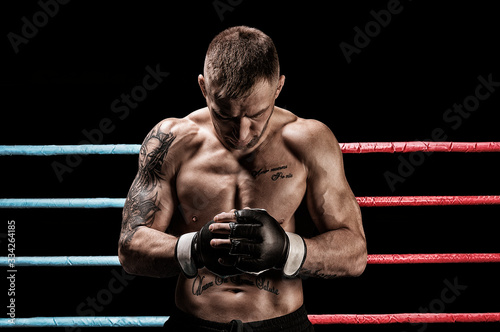 Mixed martial artist posing in boxing ring фототапет