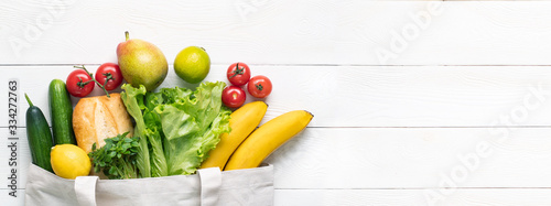 Fotografia Concept of zero waste, environmental friendly products in a textile bag on a white background with copy space for text