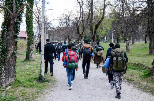 Fotografie, Obraz Police and migrants walking in Bihac, BiH