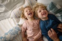 Two Small Laughing Children Wi...